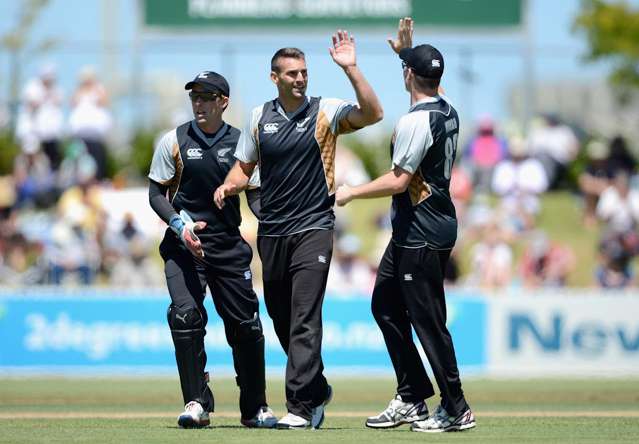WHANGAREI, NEW ZEALAND - FEBRUARY 06:  New Zealand XI captain Andrew Ellis celebrates with teammates after dismissing Luke Wright of England during a T20 Practice Match between New Zealand XI and England at Cobham Oval on February 6, 2013 in Whangarei, New Zealand.  (Photo by Gareth Copley/Getty Images)