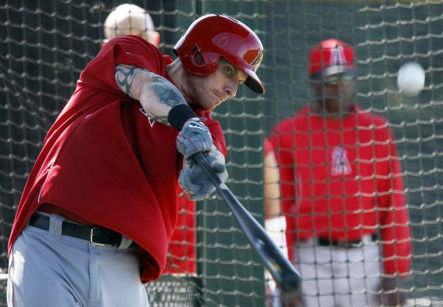 Los Angeles Angels left fielder Josh Hamilton (32) hits in the cage during spring training baseball practice, Thursday, Feb. 20, 2014, in Tempe, Ariz. (AP Photo/Rick Scuteri)