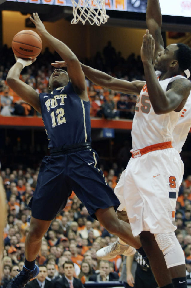 Syracuse's Rakeem Christmas, right, blocks the view of Pittsburgh's Chris Jones, left, as he shoots in the first half of an NCAA college basketball game in Syracuse, N.Y., Saturday, Jan. 18, 2014. (AP Photo/Nick Lisi)
