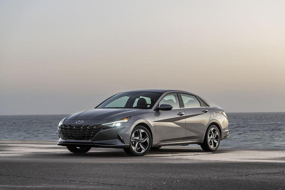 """<p>Hyundai is becoming increasingly known for daring designs, and the company's compact sedan, the 2021 Elantra, is the latest to receive a <a href=""""https://www.caranddriver.com/news/a31368284/2021-hyundai-elantra-redesign-revealed/"""" rel=""""nofollow noopener"""" target=""""_blank"""" data-ylk=""""slk:bold new look"""" class=""""link rapid-noclick-resp"""">bold new look</a>. The new Elantra sports angular exterior details and an upscale cabin, both of which are intended to pull focus away from the segment's heavy hitters—namely the <a href=""""https://www.caranddriver.com/honda/civic"""" rel=""""nofollow noopener"""" target=""""_blank"""" data-ylk=""""slk:Honda Civic"""" class=""""link rapid-noclick-resp"""">Honda Civic</a>, <a href=""""https://www.caranddriver.com/toyota/corolla"""" rel=""""nofollow noopener"""" target=""""_blank"""" data-ylk=""""slk:Toyota Corolla"""" class=""""link rapid-noclick-resp"""">Toyota Corolla</a>, and <a href=""""https://www.caranddriver.com/nissan/sentra"""" rel=""""nofollow noopener"""" target=""""_blank"""" data-ylk=""""slk:Nissan Sentra"""" class=""""link rapid-noclick-resp"""">Nissan Sentra</a>. The standard powertrain is a 147-hp four-cylinder but Hyundai also offers a 201-hp turbocharged N Line model and an available hybrid powertrain. A host of driver-assistance features are standard, with even more advanced tech offered as options.</p><p><a class=""""link rapid-noclick-resp"""" href=""""https://www.caranddriver.com/hyundai/elantra"""" rel=""""nofollow noopener"""" target=""""_blank"""" data-ylk=""""slk:Review, Pricing, and Specs"""">Review, Pricing, and Specs</a></p>"""