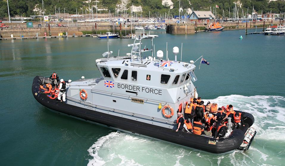 <p>A Border Force vessel went into French waters to pick up migrants and brought them back to Dover</p> (PA)