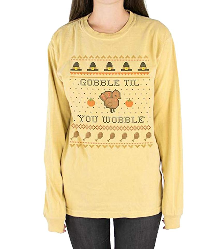 "<p>Wear this comfy long-sleeved tee on Thanksgiving and your belly will thank you later. <br /><strong><a rel=""nofollow"" href=""https://fave.co/2Pmr3YW"">Shop it:</a></strong> TeesAndTankYou Gobble Til You Wobble Long Sleeve Shirt Unisex, $26, <a rel=""nofollow"" href=""https://fave.co/2Pmr3YW"">amazon.com</a> </p>"