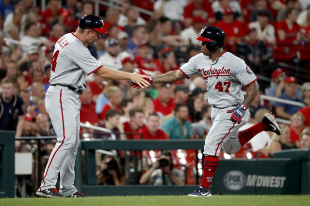 Washington Nationals' Howie Kendrick (47) is congratulated by third base coach Bob Henley after hitting a solo home run during the fourth inning of the team's baseball game against the St. Louis Cardinals on Tuesday, Sept. 17, 2019, in St. Louis. (AP Photo/Jeff Roberson)