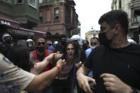 Police detain activists that tried to stage a pride event in central Istanbul, Saturday, June 26, 2021. Police used tear gas and rubber bullets to disperse the crowds and detained dozens of LGTBI activists as hundreds defied a ban and tried to stage a gay pride event. (AP Photo/Emrah Gurel)