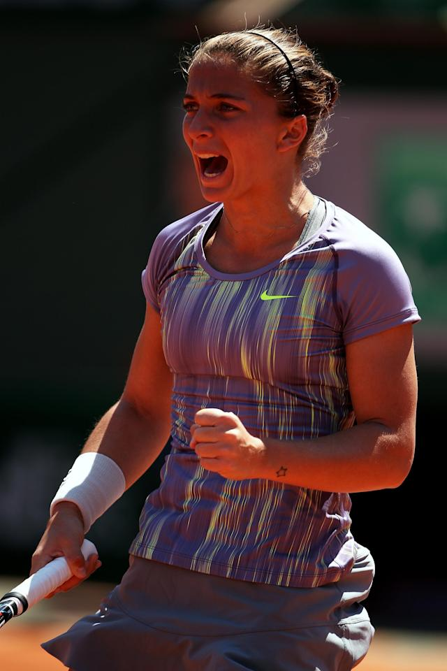 PARIS, FRANCE - JUNE 04: Sara Errani of Italy celebrates a point during her Women's Singles quarter-final match against Agnieszka Radwanska of Poland on day ten of the French Open at Roland Garros on June 4, 2013 in Paris, France. (Photo by Clive Brunskill/Getty Images)