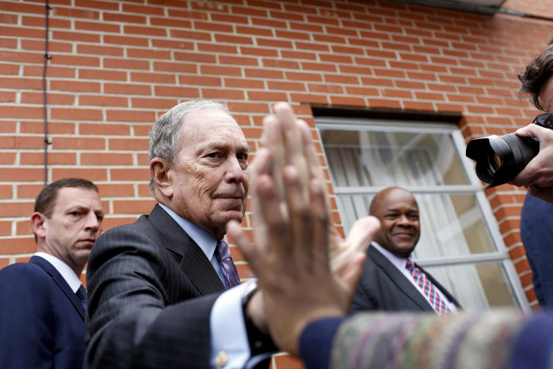 "Democratic presidential candidate, former New York City mayor Mike Bloomberg high-fives a boy as he arrives at Brown Chapel AME for a worship service in Selma, Alabama on March 1, 2020. - A resounding victory in South Carolina has thrust Joe Biden back into the race for the Democratic presidential nomination, but that could all change in two days when voters go to the polls in 14 ""Super Tuesday"" states. Buttigieg, Warren, Klobuchar and billionaire Michael Bloomberg have all made it clear that they will stick around at least through Super Tuesday. (Photo by Joshua Lott / AFP) (Photo by JOSHUA LOTT/AFP via Getty Images)"