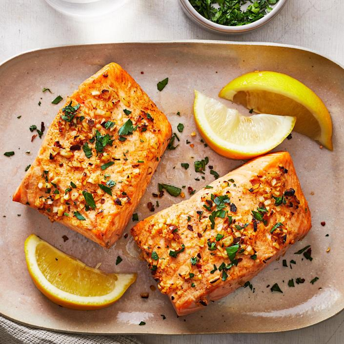 """<p>In this simple air-fryer salmon recipe, the garlic gets crispy on the top while the Aleppo pepper and coriander bring earthy flavor to the fish, which remains delicately cooked in the middle. <a href=""""https://www.eatingwell.com/recipe/7888942/air-fryer-salmon/"""" rel=""""nofollow noopener"""" target=""""_blank"""" data-ylk=""""slk:View recipe"""" class=""""link rapid-noclick-resp""""> View recipe </a></p>"""