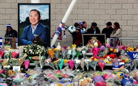FILE PHOTO: Fans react on the day a book of condolence opened for Leicester City's owner Thai businessman Vichai Srivaddhanaprabha, and four other people who died when their helicopter crashed as it left the ground after the match on Saturday, at the King Power Stadium, in Leicester, Britain October 30, 2018. REUTERS/Eddie Keogh