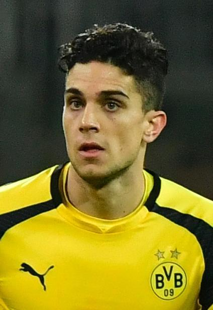 Dortmund's Spanish defender Marc Bartra was injured after he was hit by splinters of broken glass during three explosions rocked the Borussia Dortmund bus (AFP Photo/John MACDOUGALL)