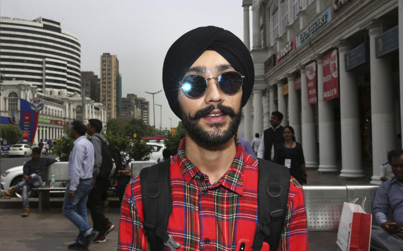 "In this Tuesday, April 16, 2019, photo, Rajanvir Singh Luthra, 23, a You Tube vlogger, stands for a photograph in New Delhi, India. With nearly half the electorate under 35 and more than 15 million first time voters, India's young can swing the national vote in the world's largest democracy in any direction. ""Whichever government comes to power, the first thing they should do is to look after the poor because the rate of poverty is very high in India. No doubt, we now have digital India, we have everything online, but do something for the poor people also,"" Luthra told the Associated Press. (AP Photo/Manish Swarup)"