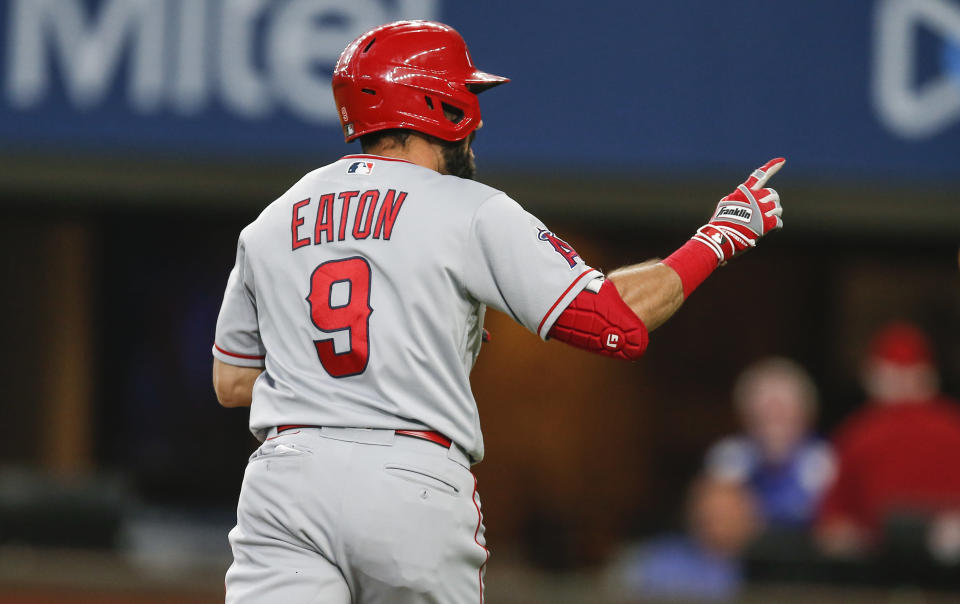 Los Angeles Angels' Adam Eaton (9) celebrates after hitting a solo home run in the third inning of a baseball game against the Texas Rangers, Thursday, Aug. 5, 2021, in Arlington, Texas. (AP Photo/Brandon Wade)
