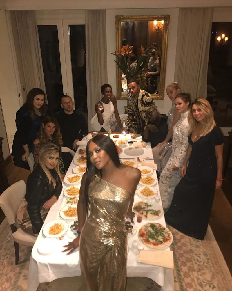 "After the Versace show, the menu for a crew of hungry supermodels included French fries and pizza. ""#carbing out after #versace,"" captioned Naomi Campbell, pictured with Maria Borges, Jasmine Sanders and more. (Sanders, alias Golden Barbie, posted the same photo, captioned ""Carbs with the Queen."")"