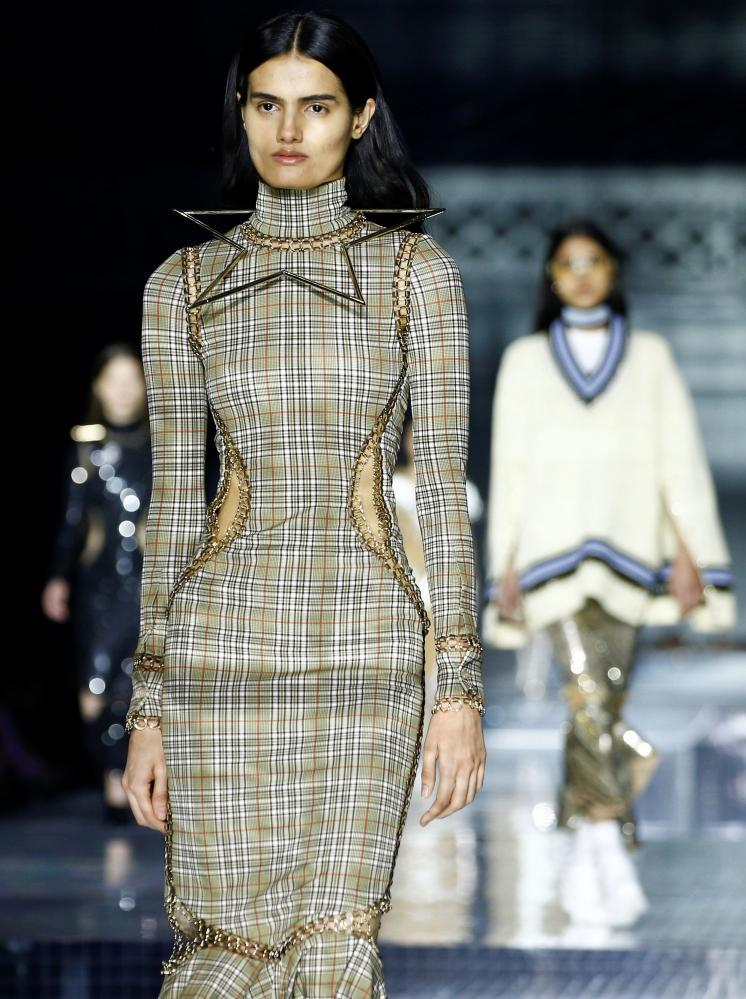 Models present creations during the Burberry catwalk show