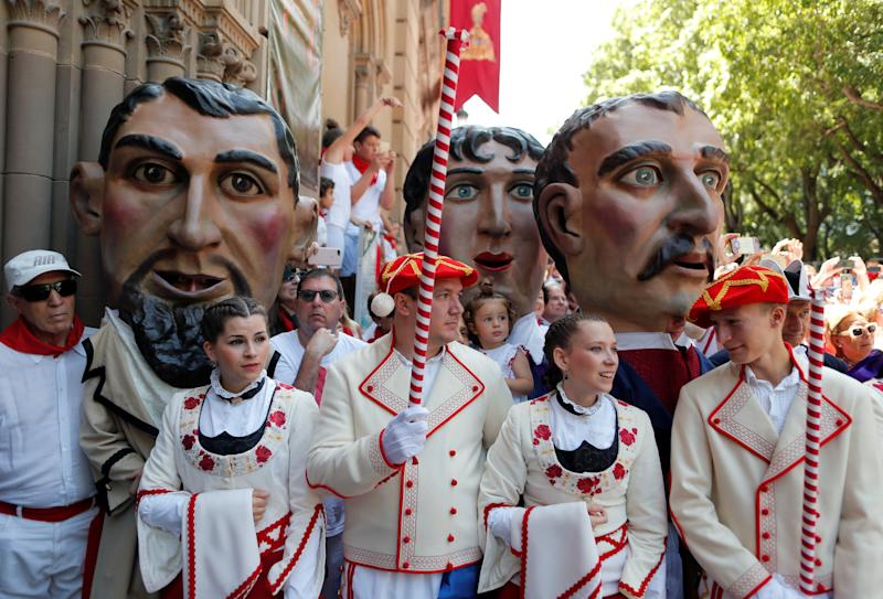 """Cabezudos"" (Big heads) and dancers take part in a procession of the Saints Day after the first running of the bulls at the San Fermin festival in Pamplona, Spain, July 7, 2019. (Photo: Jon Nazca/Reuters)"