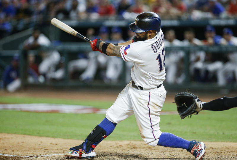 Texas Rangers' Rougned Odor makes contact for a grand slam during the sixth inning of a baseball game against the New York Yankees, Saturday, Sept. 28, 2019, in Arlington, Texas. (AP Photo/Brandon Wade)