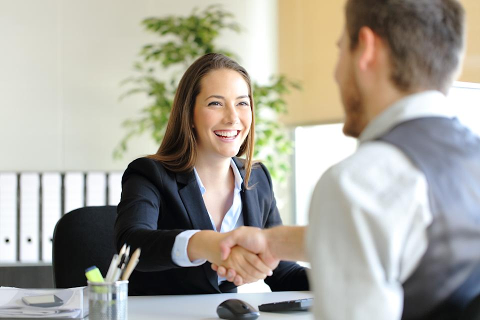 Businesspeople shaking hands after an interview