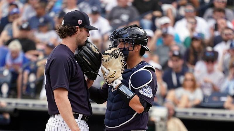 Yankees' Gerrit Cole talks with catcher Kyle Higashioka in spring training game