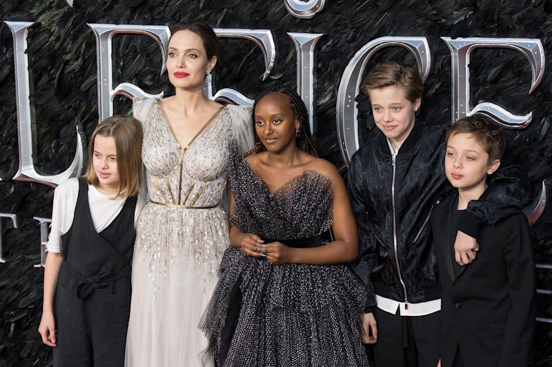 "LONDON, ENGLAND - OCTOBER 09: (L-R) Vivienne Marcheline Jolie-Pitt, Angelina Jolie, Zahara Marley Jolie-Pitt, Shiloh Nouvel Jolie-Pitt and Knox Jolie-Pitt attend the European premiere of ""Maleficent: Mistress of Evil"" at Odeon IMAX Waterloo on October 09, 2019 in London, England. (Photo by Jeff Spicer/Getty Images)"