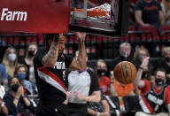 Portland Trail Blazers forward Norman Powell dunks the ball during the second half of Game 4 of an NBA basketball first-round playoff series against the Denver Nuggets in Portland, Ore., Saturday, May 29, 2021. The Blazers won 1115-95. (AP Photo/Steve Dykes)