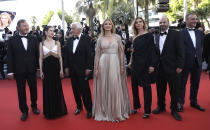 Olivier Rabourdin, from left, Daphne Patakia, director Paul Verhoeven, Virginie Efira, Clotilde Courau, David Birke, and Michel Merkt pose for photographers upon arrival at the premiere of the film 'Benedetta' at the 74th international film festival, Cannes, southern France, Friday, July 9, 2021. (Photo by Vianney Le Caer/Invision/AP)