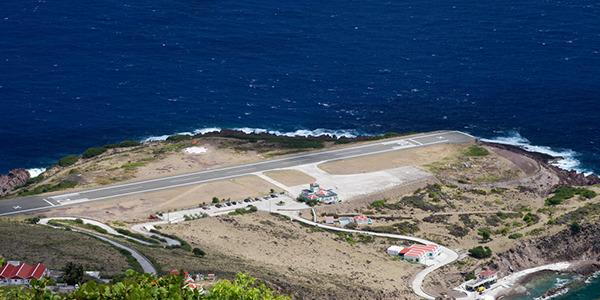 "<a rel=""nofollow"" href=""http://au.totaltravel.yahoo.com/destinations/""><b>Saba Island, Caribbean </b></a> <br /><br/> Here on this Caribbean island, the only airport juts briefly out into the ocean. Billed as one of the shortes runways in the world, there is a high possibility of overshooting the runway and ending up in the ocean.<br/><br/>"