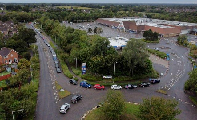 Motorists queue for a petrol station to open at a Tesco in Ashford, Kent