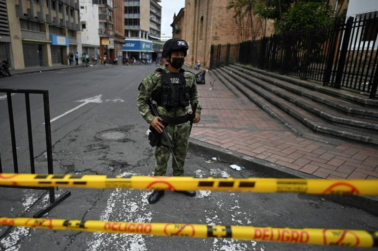 A Colombian soldier guards a road in Cali following a month of anti-government protests