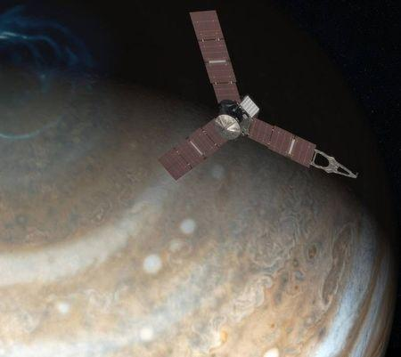 File photo of artist's rendering depicts NASA's Juno spacecraft above Jupiter's north pole in this undated handout image