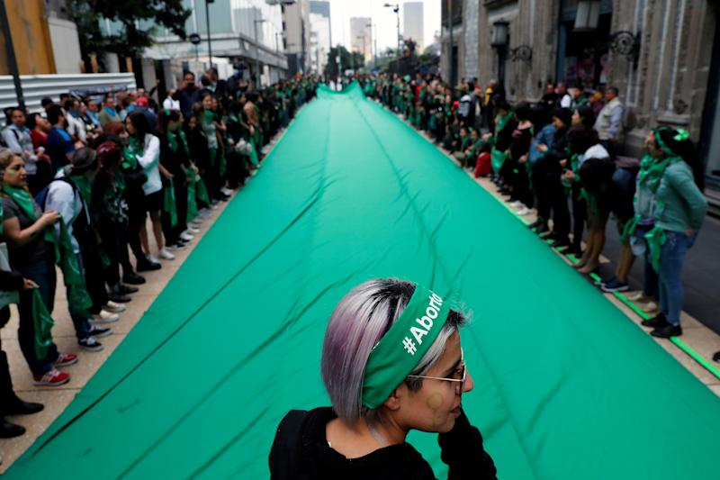 "Activists, part of a movement known as ""Marea Verde"" take part in a performance to film a message to spread awareness during the International Safe Abortion Day in Mexico City, Mexico September 28, 2019. REUTERS/Carlos Jasso"