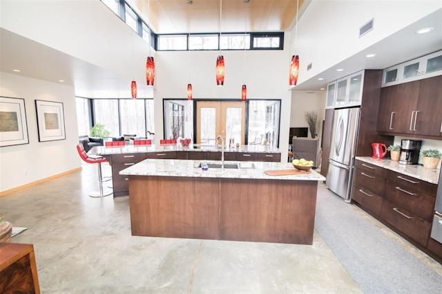 <p><span>50516 Range Road 225, Rural Leduc County, Alta.</span><br>The professional gourmet kitchen has custom cabinetry, granite counters and double islands.<br> (Photo: Zoocasa) </p>