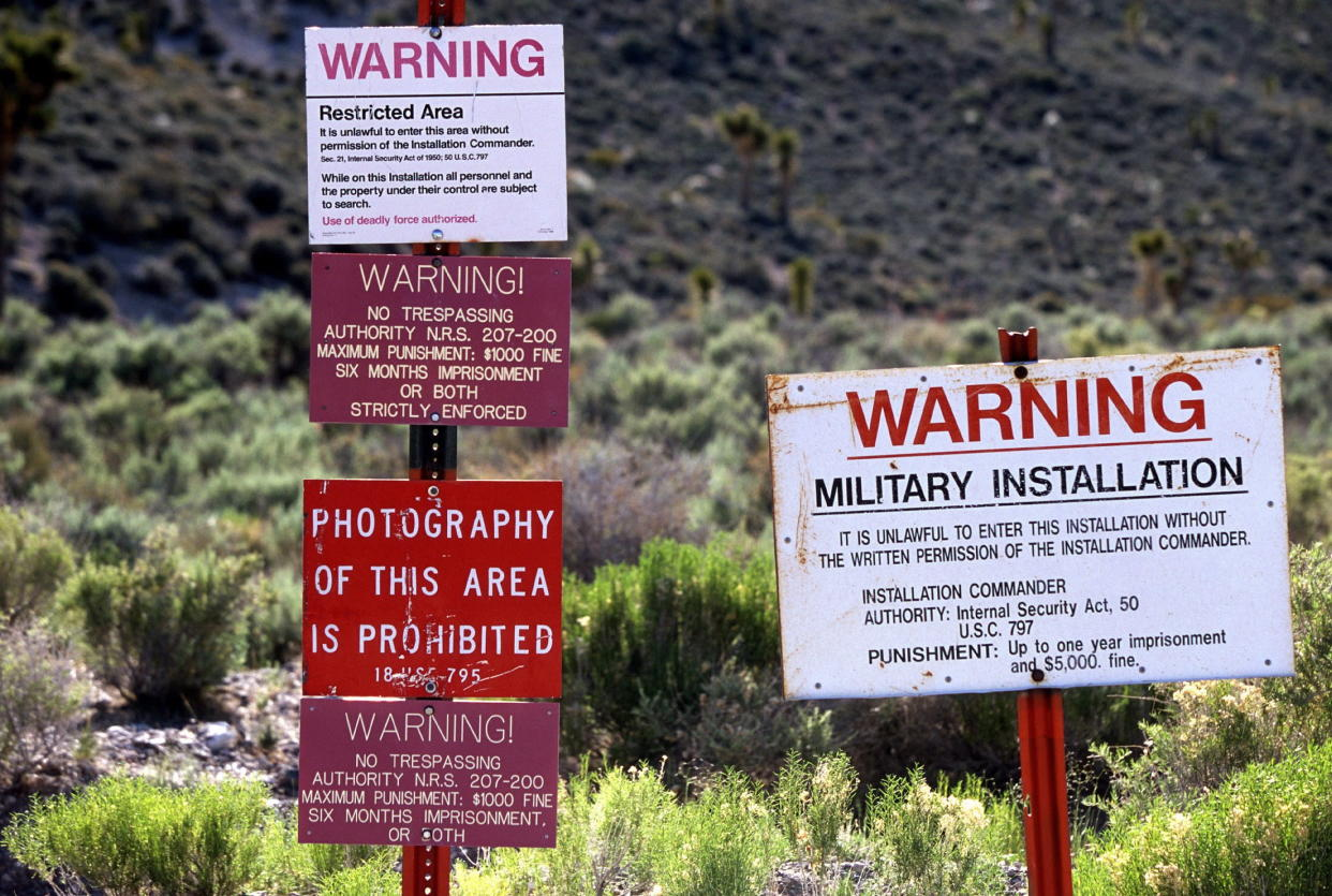 Warning signs at the restricted boundary to Area 51 on an unmarked dirt road near the town of Rachel, Nev. (Photo: Larry MacDougal/ZUMA Wire)