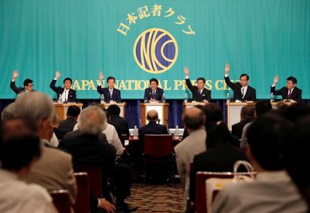 Japan's Prime Minister Shinzo Abe, who is also ruling Liberal Democratic Party leader, attends a debate session ahead of July 21 upper house election with other party leaders in Tokyo
