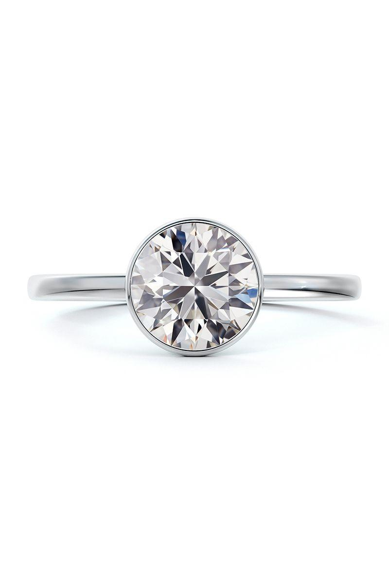 "<p><em><strong>Forevermark</strong> ""Micaela's Hidden Halo"" Bezel Set Engagement Ring, from $5,305, <a href=""https://www.forevermark.com/"" rel=""nofollow noopener"" target=""_blank"" data-ylk=""slk:forevermark.com"" class=""link rapid-noclick-resp"">forevermark.com</a>.</em><br></p><p><a class=""link rapid-noclick-resp"" href=""https://www.forevermark.com/"" rel=""nofollow noopener"" target=""_blank"" data-ylk=""slk:SHOP"">SHOP</a></p>"