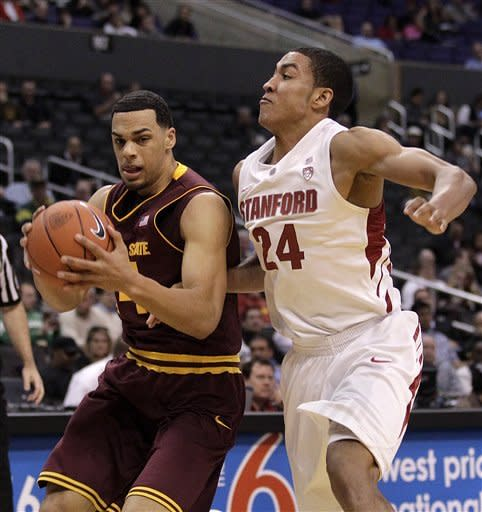 Arizona State's Trent Lockett, left, is pressured by Stanford's Josh Huestis (24) during the first half of an NCAA college basketball game at the Pac-12 Conference tournament in Los Angeles, Wednesday, March 7, 2012. (AP Photo/Jae C. Hong)