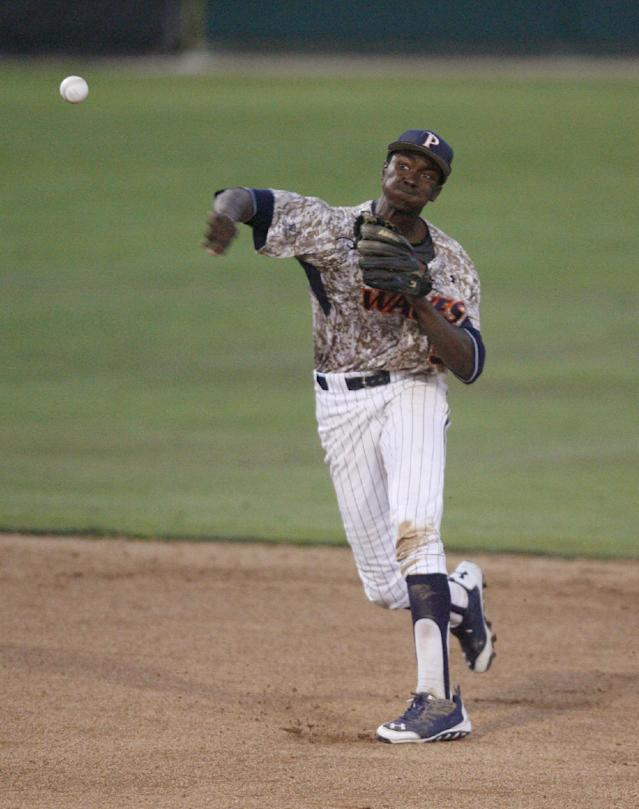 Pepperdine shortstop Manny Jefferson throws to first for the final out of an NCAA college baseball tournament regional game against Cal Poly on Saturday, May 31, 2014, at Baggett Stadium at Cal Poly in San Luis Obispo, Calif. (AP Photo/Aaron Lambert)