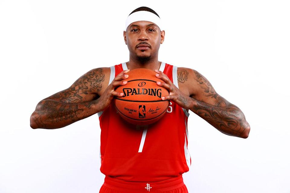 """While <a class=""""link rapid-noclick-resp"""" href=""""/nba/players/3706/"""" data-ylk=""""slk:Carmelo Anthony"""">Carmelo Anthony</a> didn't endorse the idea of playing off the bench in Houston, his attitude is a far cry from his flippant response in OKC. (Getty)"""