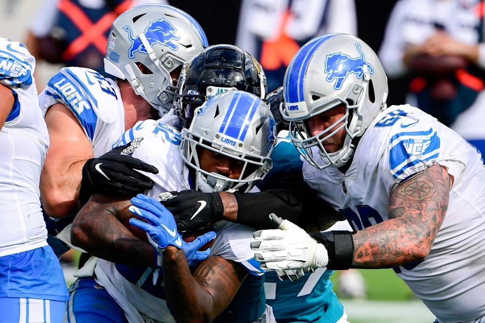 Detroit Lions running back D'Andre Swift (32) runs the ball in for a touchdown against the Jacksonville Jaguars during the second half on Sunday, Oct. 18, 2020 at TIAA Bank Field.