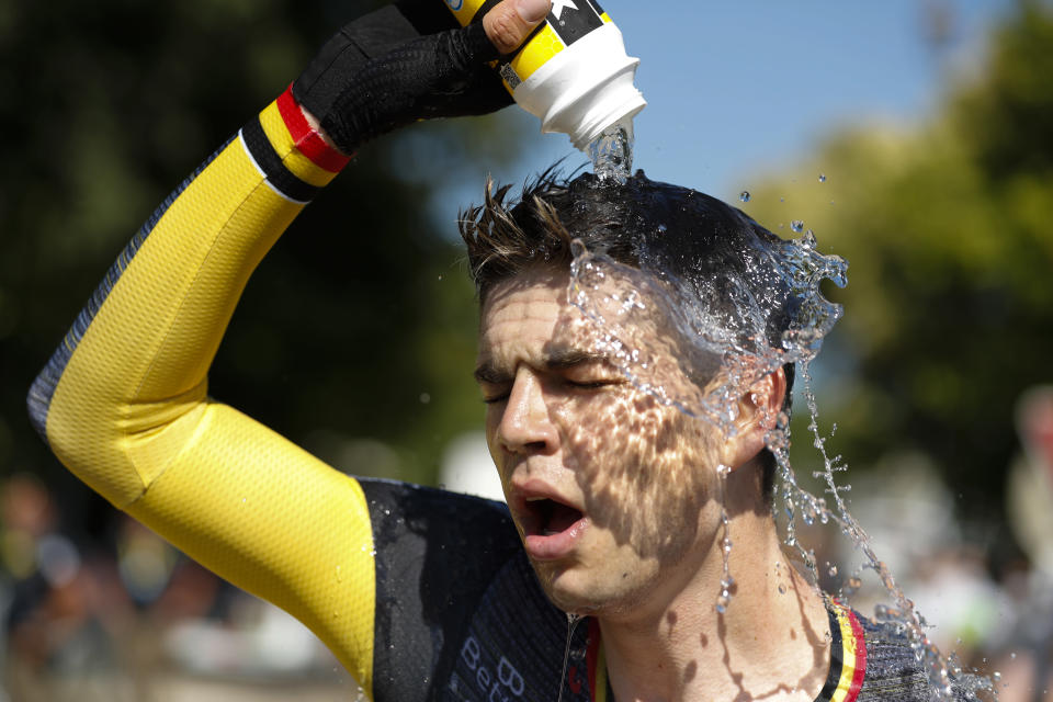 Belgium's Wout Van Aert cools off after the twentieth stage of the Tour de France cycling race, an individual time-trial over 30.8 kilometers (19.1 miles) with start in Libourne and finish in Saint-Emilion, France,Saturday, July 17, 2021. (Tim van Wichelen/Pool Photo via AP)