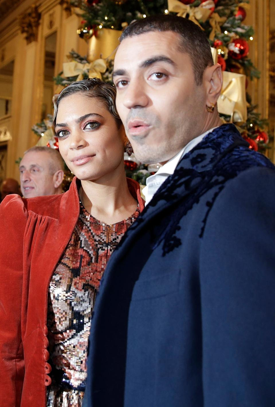 """Rapper Marracash is flanked by his partner singer Elodie as they arrive for the gala premiere of La Scala opera house, in Milan, Italy, Saturday, Dec. 7, 2019. Milan's storied La Scala opens its 2019-2020 season on Saturday with Puccini's """"Tosca,"""" which stars Russian soprano Anna Netrebko as the object of unwanted sexual attention from a powerful authority figure. (AP Photo/Luca Bruno) (Photo: ASSOCIATED PRESS)"""