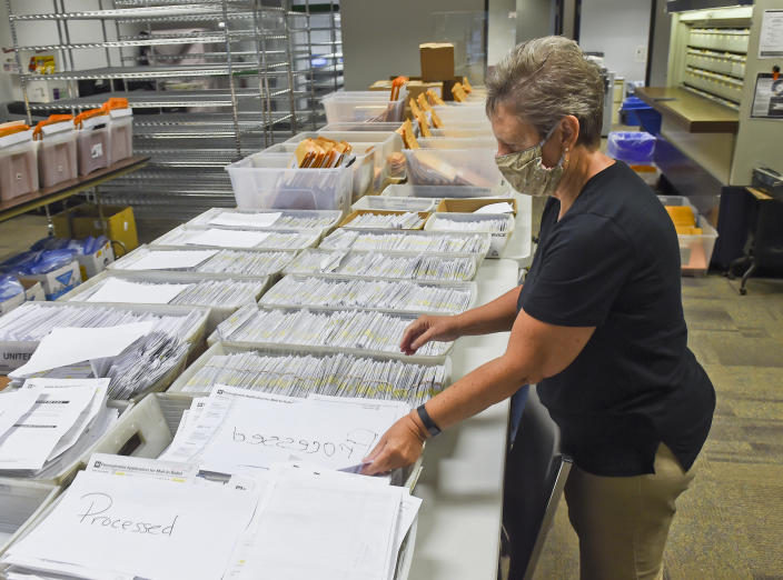 Donna Blatt, chief registrar of Berks County, Pa., with applications for mail-in ballots. (Ben Hasty/MediaNews Group/Reading Eagle via Getty Images)
