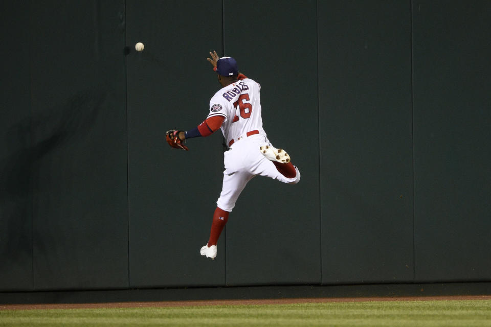 Washington Nationals center fielder Victor Robles misses the ball on a triple by St. Louis Cardinals' Dylan Carlson during the seventh inning of a baseball game Tuesday, April 20, 2021, in Washington. (AP Photo/Nick Wass)