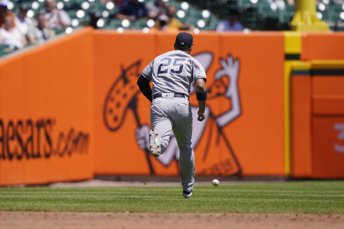 New York Yankees shortstop Gleyber Torres misplays the ball hit by Detroit Tigers Victor Reyes during the third inning of a baseball game, Sunday, May 30, 2021, in Detroit. (AP Photo/Carlos Osorio)