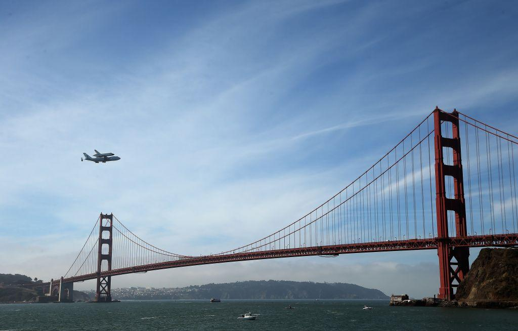 Golden Gate Bridge, San Francisco, USA:  The space shuttle Endeavour, on top of NASA's Shuttle Carrier Aircraft or SCA, makes a pass over the Golden Gate Bridge before making its final landing in Los Angeles in San Francisco, California.