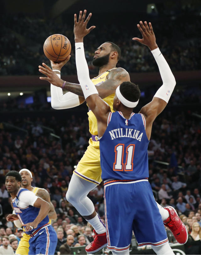 New York Knicks guard Frank Ntilikina (11) defends as Los Angeles Lakers forward LeBron James (23) goes up for two points during the first half of an NBA basketball game in New York, Wednesday, Jan. 22, 2020. (AP Photo/Kathy Willens)