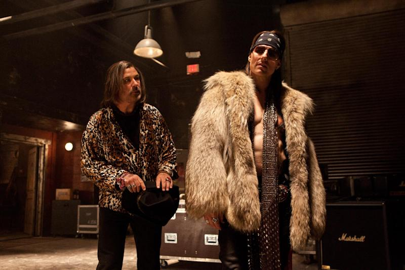 """This film image released by Warner Bros. Pictures shows Alec Baldwin as Dennis Dupree, left, and Tom Cruise as Stacee Jaxx in New Line Cinema's rock musical """"Rock of Ages,"""" a Warner Bros. Pictures release. (AP Photo/Warner Bros. Pictures, David James)"""