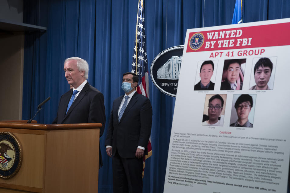 Deputy Attorney General Jeffery Rosen speaks, Wednesday, Sept. 16, 2020 at the Justice Department in Washington. The Justice Department has charged five Chinese citizens with hacks targeting more than 100 companies and institutions in the United States and abroad, including social media and video game companies as well as universities and telecommunications providers. Officials announced the prosecution on Wednesday. (Tasos Katopodis/Pool via AP)