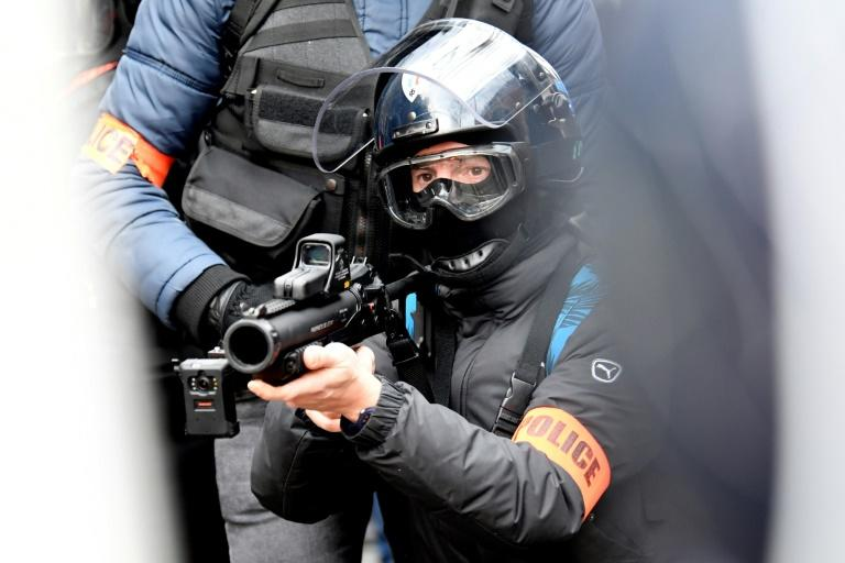 The use by French police of the defensive ball launcher (LBD 40) has been condemned by critics in France and abroad after a number of protesters lost eyes after being hit by the projectiles (AFP Photo/Bertrand GUAY)