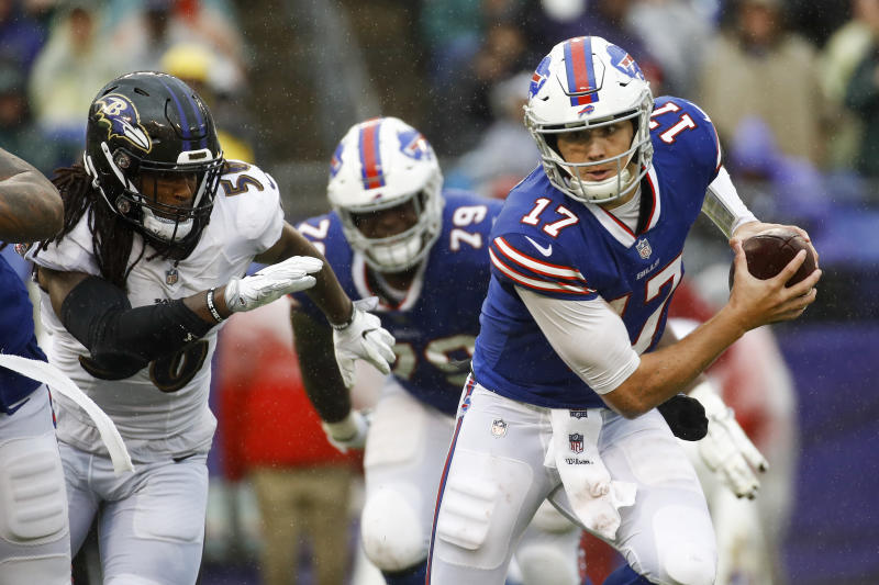 Buffalo Bills quarterback Josh Allen (17) scrambles away from Baltimore Ravens linebacker Tim Williams (56) with the ball during the second half of an NFL football game, Sunday, Sept. 9, 2018, in Baltimore. (AP Photo/Patrick Semansky)