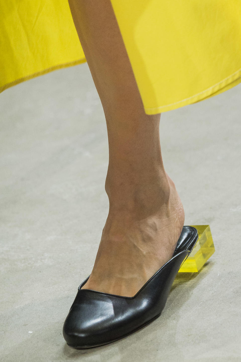 <p><i>Black mules with clear yellow block heel from the SS18 Prabal Gurung collection. (Photo: ImaxTree) </i></p>