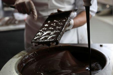 A man gives a chocolate demonstration inside The Chocolate Museum in New York